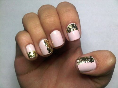 pink nails with gold glitter.