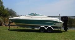 Sea Ray 200 Overnighter - $9,995.  1994 Sea Ray 200 Overnighter Signature Cuddy Cabin powered by a Mercury 2.0litre 135 HP outboard motor.  1994 Shorelandr tandem axle aluminum trailer.  Package is equipped with a stainless steel prop, power trim and tilt, AM/FM/Cassette stereo, compass, depth finder, dual batteries with switch, full boat cover, convertible top with camper enclosure, docking lights, stainless steel bow & stern eyes, recessed stainless steel cleats and more.