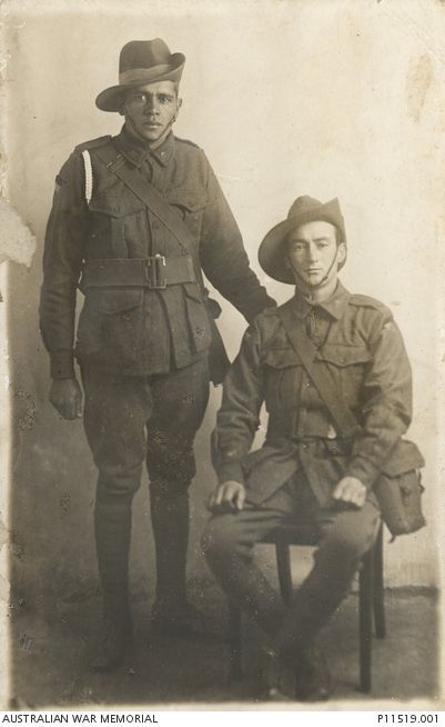 """The two comrades"". Studio portrait of an indigenous soldier, 7685 Private (Pte) Norman Baird (left), and 7846 Pte Benjamin Dallow, both of the 9th Battalion. Pte Baird, a miner from Cooktown"