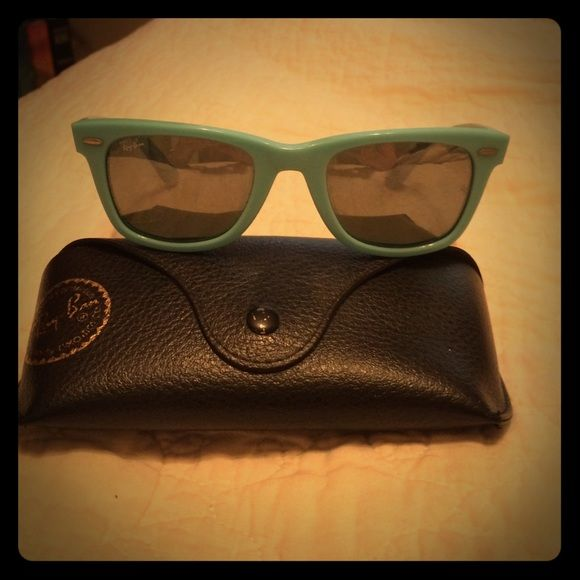1 day sale! Authentic Ray Ban Wayfarer Sunglasses Turquoise Ray Ban Wayfarer sunglasses. Excellent condition! Comes with original protective case & dust cloth. Make me a reasonable offer! :) Ray-Ban Accessories Sunglasses