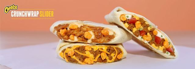 "Taco Bell Serving Cheetos Crunchwrap Sliders in Canada  Taco Bell is now serving Cheetos Crunchwrap Sliders in its Canadian stores. The sliders come in three different optionsbeefy cheddar spicy chicken and supreme.   Cheeto's Crunchwrap Slider via Taco Bell Canada  The company's Cheetos Crunchwrap Slider is a smaller-sized Crunchwrap infused with a ""new flavor profile"" that combines its crunchwrap with Cheetos jalapeno snacks. Beefy cheddar combines Taco Bell's ""signature season ground…"