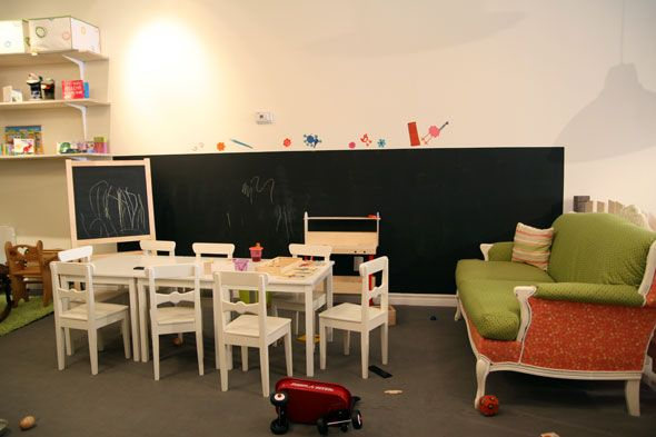 Low black board wall would be fun! Love the low long table and chairs as well.