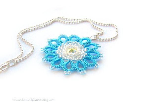 Blue tatted lace pendant with white beadwork and Swarovski rivoli in center. Beautiful, delicate floral pendant in fantasy style,…