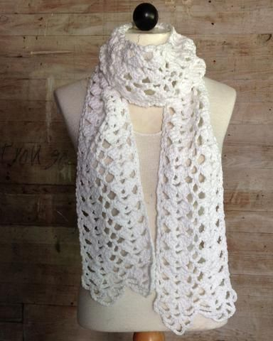 """Watch the review video for the beautiful Lacy Shells Scarf Crochet Pattern! Original Design By: Maggie Weldon Skill Level: Easy Size: About 6½"""" wide and 72"""" long Materials: Worsted Weight Cotton Yarn More"""