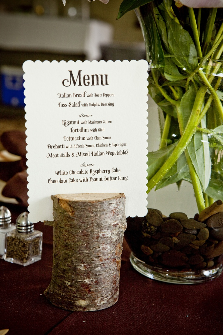 The placement of a menu card on each of your wedding guest tables is a nice decor touch! It also provides one more way to tie all your wedding paper products together.