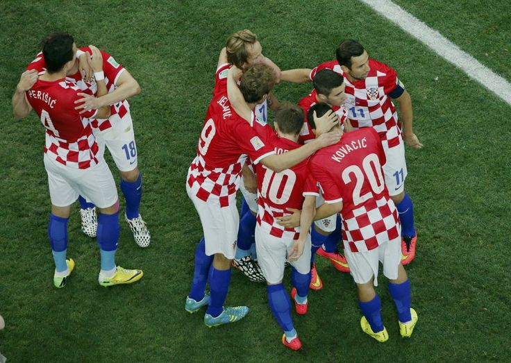 Brazil v Croatia: Group A - 2014 FIFA World Cup Brazil - Croatia's players celebrate an own goal by Brazil's Marcelo during their 2014 World Cup opening match at the Corinthians arena in Sao Paulo June 12, 2014. (REUTERS/Fabrizio Bensch)