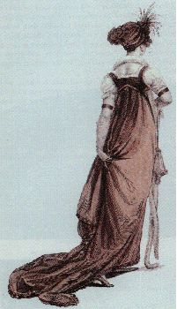 1803 This dress has a matching turban trimmed with a spray of short feathers. The fur tippet around the lady's neck reaches to the floor. Two bracelets are worn high on the arms between the short sleeves and long gloves. The purse and slippers are in a slightly lighter shade than the rust of the dress.