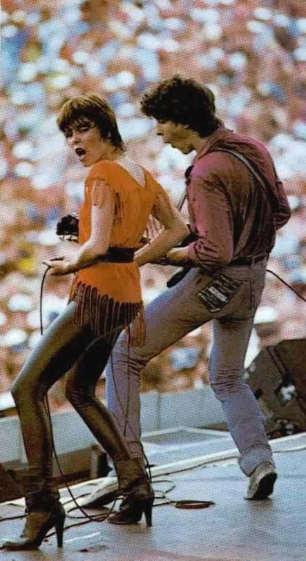 Pat Benatar & Neil Giraldo on stage.