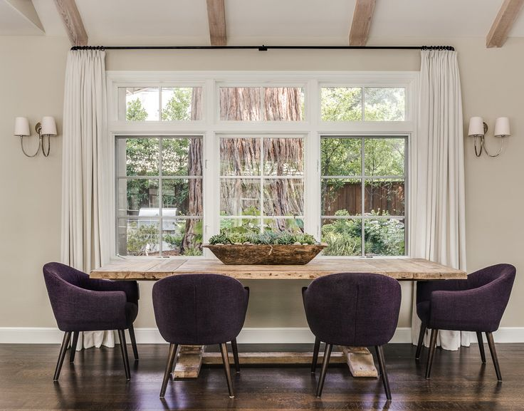 Chic Dining Room Boasts A Salvaged Wood Dining Table, Pushed Against A Wall  With Windows Dressed In White Curtains, Lined With Purple Linen Dining  Chairs ...