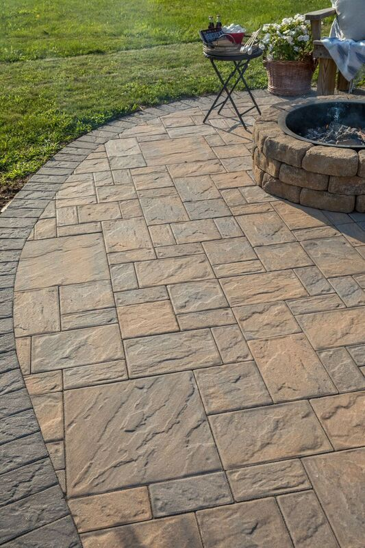 Check out this beautiful patio and fire pit installed using Cambridge Pavingstones with ArmorTec! Installation:Meyer for Hire