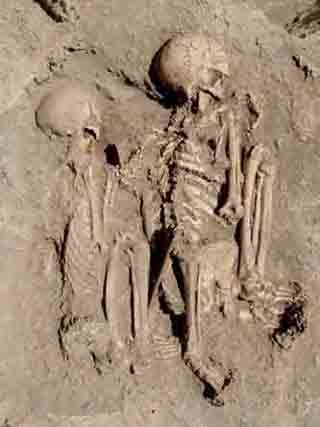 Two ancient skeletons found in each other's arms in a grave in Turkey might be the oldest known embracing couple, archaeologists say. The remains, believed to be those of a 30-year-old man and a 20-year-old woman, were found last week in the southeastern Turkish province of Diyarbakir. The team carrying out the excavations found the remains under the floor of an ancient house at the Hakemi Use excavation site in Turkey's Bismil district. The researchers dated the skeletons to 6100 B.C.,