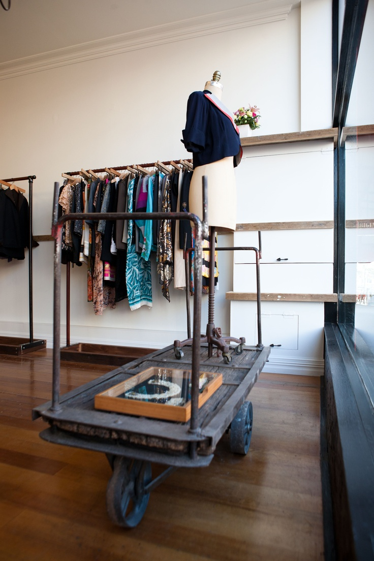 Robe - a new fashion store at 351 Smith St Fitzroy, Melbourne.  Custom fit-out by Sime Nugent using reclaimed wood and steel.  Antique railway luggage trolley window display.  Preloved clothing from New York & LA; bespoke designs by Melbourne designer Mona Meighan.