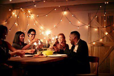 Love gathering under patio lights. Shot by Sandy Nicholson