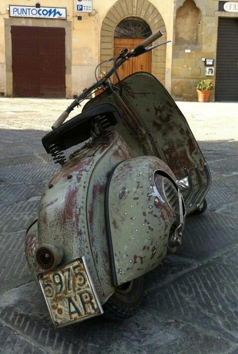 pinterest.com/fra411 #classic Vespa - I really Love this one the best! It looks like it's been around the globe at least once!