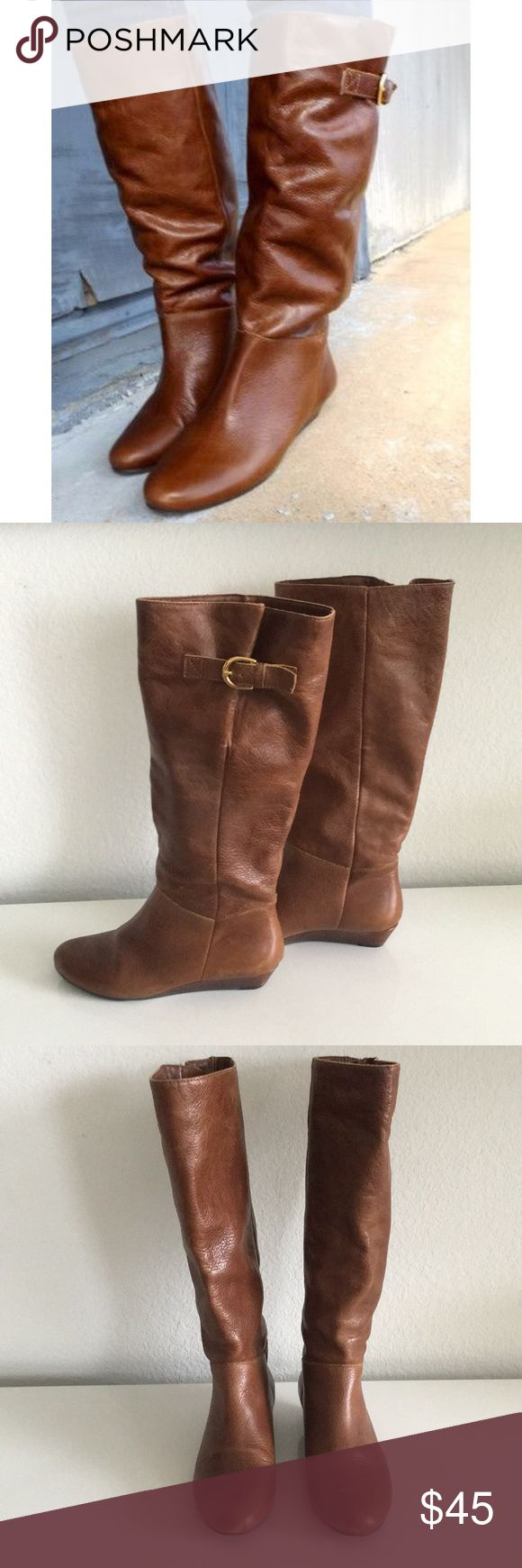 """Steven by Steve Madden Intyce Boots Sz 6 Cognac colored boots with gold buckle detail and 1"""" silver wedge heel. Leather upper material. Man made some. Shaft height is 15.75"""". Shaft circumference is 20"""". Worn a handful of times, but in good condition. However has minor scuffs at toes and nick at the back of left boot (see pics). Price reflects wear. Box not included. No trades or PayPal. Steven By Steve Madden Shoes"""