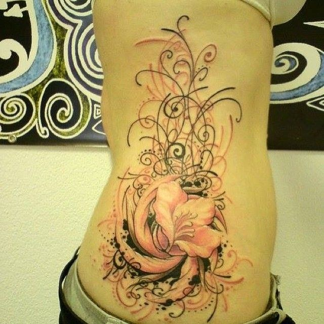 Abstract flower tattoo, more at http://tattoo-swag.com/abstract-flower-tattoo-design/