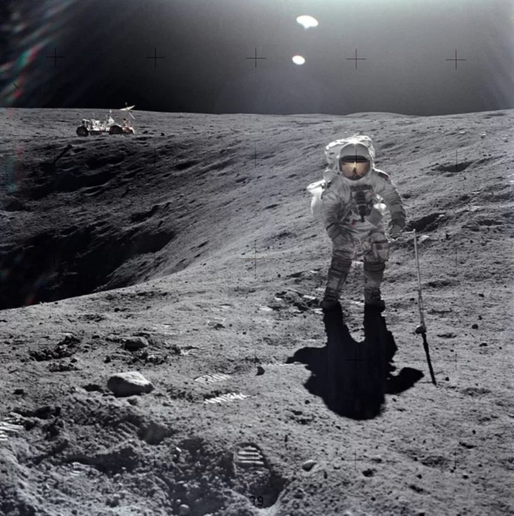 Astronaut John W. Young, the commander of Apollo 16, captured this image of Charles Duke collecting lunar samples near Plum Crater. Credit: NASA