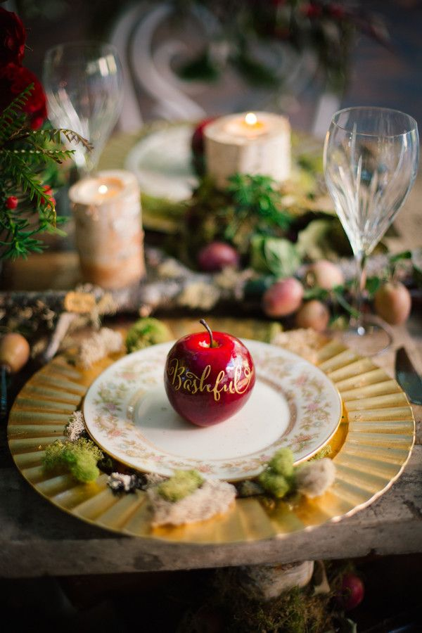These Snow White Wedding Ideas will blow you away! Filled with ruby red apples atop whimsically designed tables you must see more! Claire Marika Photography