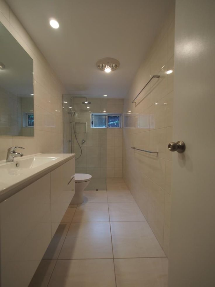 Walk-in shower - glass panel shower screen and twin shower on rail.