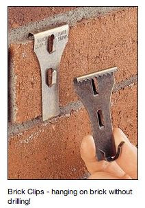 how to hang on brick
