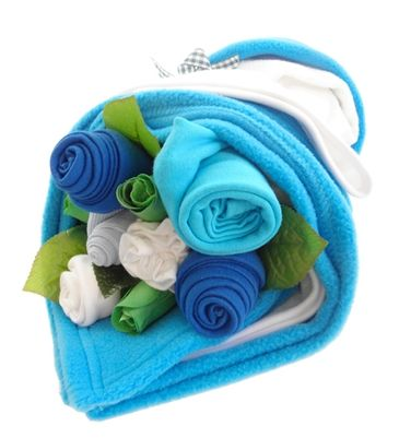This lovely bundle of baby clothes is styled like our traditional flower arrangements but with added extras and a bright turquoise twist.  Filled with baby socks, bibs, bodysuit, hat, scratch mitts, fleece blanket and soft hooded bath towel, it's complete with artificial greenery and flowers. This gorgeous turquoise baby bundle is a perfect gift for a baby boy.