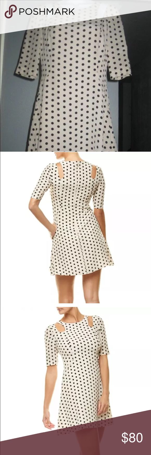 """Patrizia Pepe Polka Dot Dress Cold Shoulder Sz 6 Patrizia Pepe Polka Dot Tan and Black Silk Dress Cold Shoulder Sz US6 IT42 Creme and black Patrizia Pepe sleeveless dress with scoop neck, short sleeves featuring cutout shoulders, polka dot print throughout and concealed zip closure at back.DETAILS:  Shell: 100% Silk; Lining: 100% Polyester   Estimated Retail: $260.00 Condition: Pristine Fabric: 100% Silk Measurements: Bust 36"""", Waist 30"""", Hip 37"""", Length 33"""" Designer: Patrizia Pepe Patrizia…"""