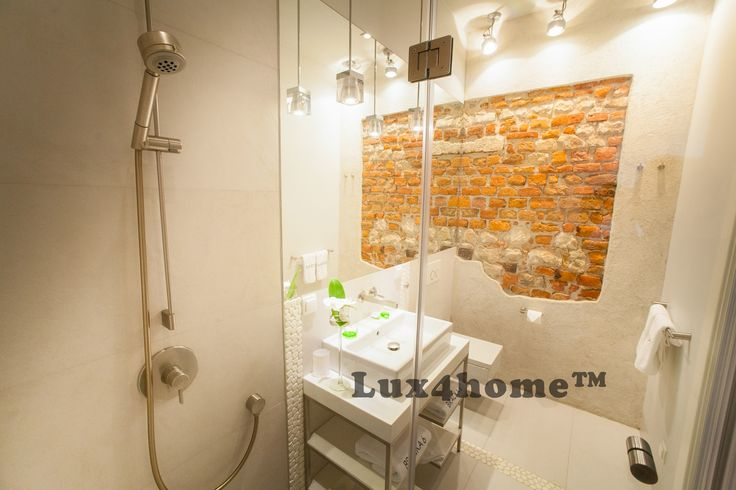#Pebble Tiles in Bathroom. Black & White Pebble - Lux4home™. Apartments in Bracka Street - Krakow - Poland.  Lux4home™