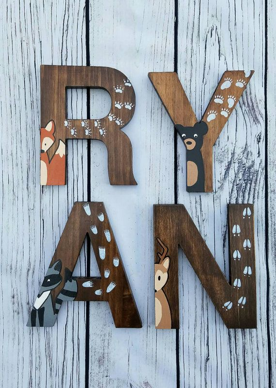 The price of the listing is for INDIVIDUAL LETTERS. When ordering please select ALL the letters in the NAME, then include the name in the note to seller section of the checkout page.  Natural Pine 8 Wooden letters, in Helvetica font, which are hand stained on all sides with a Walnut Stain. Then, a woodland creature and its tracks are hand painted on each letter. Since I use natural wood letters, imperfections such as knots in the wood, will be seen.  Many of the letters can be displayed free…