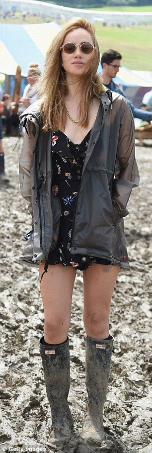Models with an edge: Suki Waterhouse and Cara Delevingne prepared to get a little muddy as they swapped their high heels for wellies for day three of Glastonbury in Somerset on Saturday