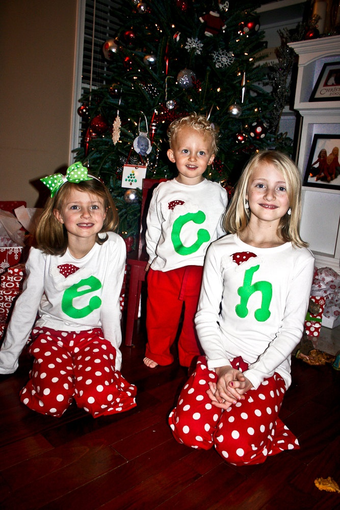 Christmas Pajama Shirt with Santa Hat and Initial Great for Christmas Pajamas for boys and girls. $31.45, via Etsy.