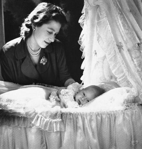 Princess Elizabeth admires her infant son, Prince Charles Philip Arthur George of Edinburgh, at Buckinham Palace, on Dec. 23, 1948.