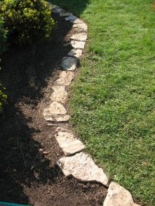 Flat rock border, doesn't need to be level where yard slopes