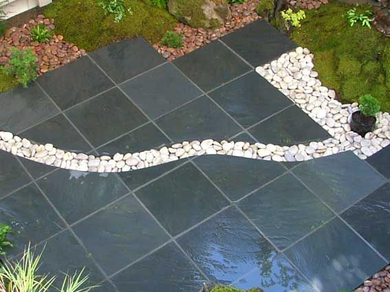Slate Patio On A Concrete Slab With A Dry River Bed Of Snowball Cobbles  Designed To Display The Homeowneru0027s Collection Of Garden Sculpture. We Usedu2026