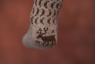 This is a sock with a fairly simple color work pattern. The size is easily adjustable for the moderately confident sock knitter. The motif on the heel is worked in intarsia, just enough to get a taste for intarsia knitting.