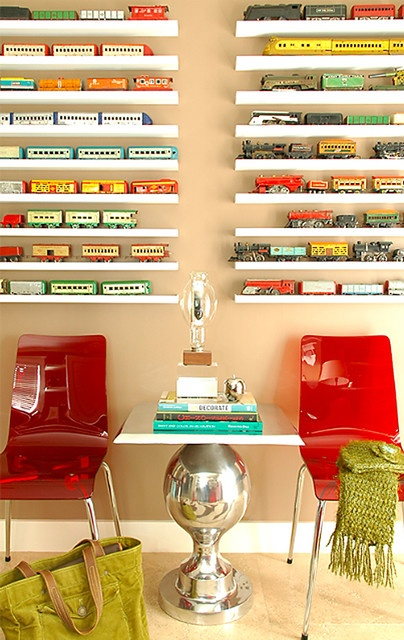 toy trains on small shelves. so cute. Modern Office contemporary home office