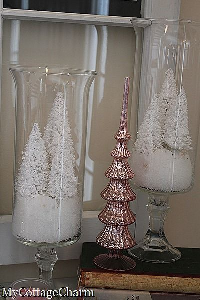 Dollar Tree Christmas candlestick epoxyed to cylinders or beckers.
