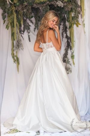 Our Huntsville Bridal Shop loves the Meadow Gown by Modern Trousseau. This gorgeous dress is available at our Alabama Bridal Shop - White Dresses!