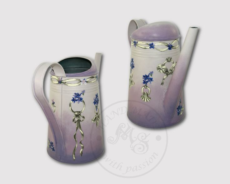 The lilac watering can decorated with classic decoupage and print room.