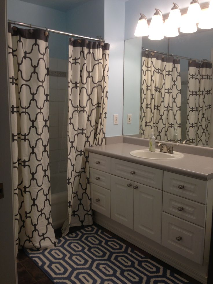 Two Shower Curtains And A Fun Rug Blue Walls With New
