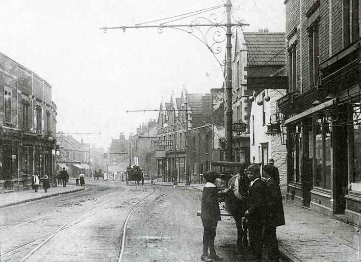 West Street, Bedminster, around the turn of the century. Note the by-products of horse transport all over the road (handy for the garden) When they are out of work these people eke out a miserable existence by begging and stealing, by sweeping the streets, by collecting horse-dung This was the main thoroughfare into Bristol for carriers from the agricultural areas to the south.