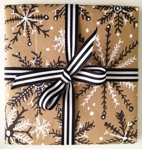 black marker and white out pen on paper bag to make wrapping paper