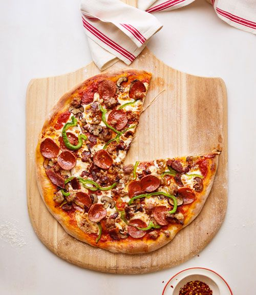 Calling all carnivores! Pile sweet Italian sausage, pepperoni, bacon, mushrooms, and green peppers onto a chewy, puffy crust. Get the recipe for Meat Lovers' Supreme Pizza   - GoodHousekeeping.com