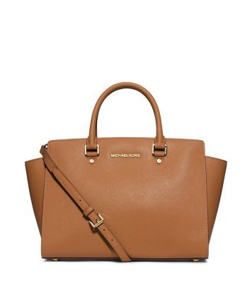 Architectural and unique, this spacious satchel adds contemporary edge to every ensemble. With a sleek silhouette, oversized drop handles and an extra-long shoulder strap, it's exceptionally versatile. We love to carry it at the elbow for a major statement, or across the chest as a carefree crossbody. Whatever your preference, you can't go wrong with this ever-elegant design.