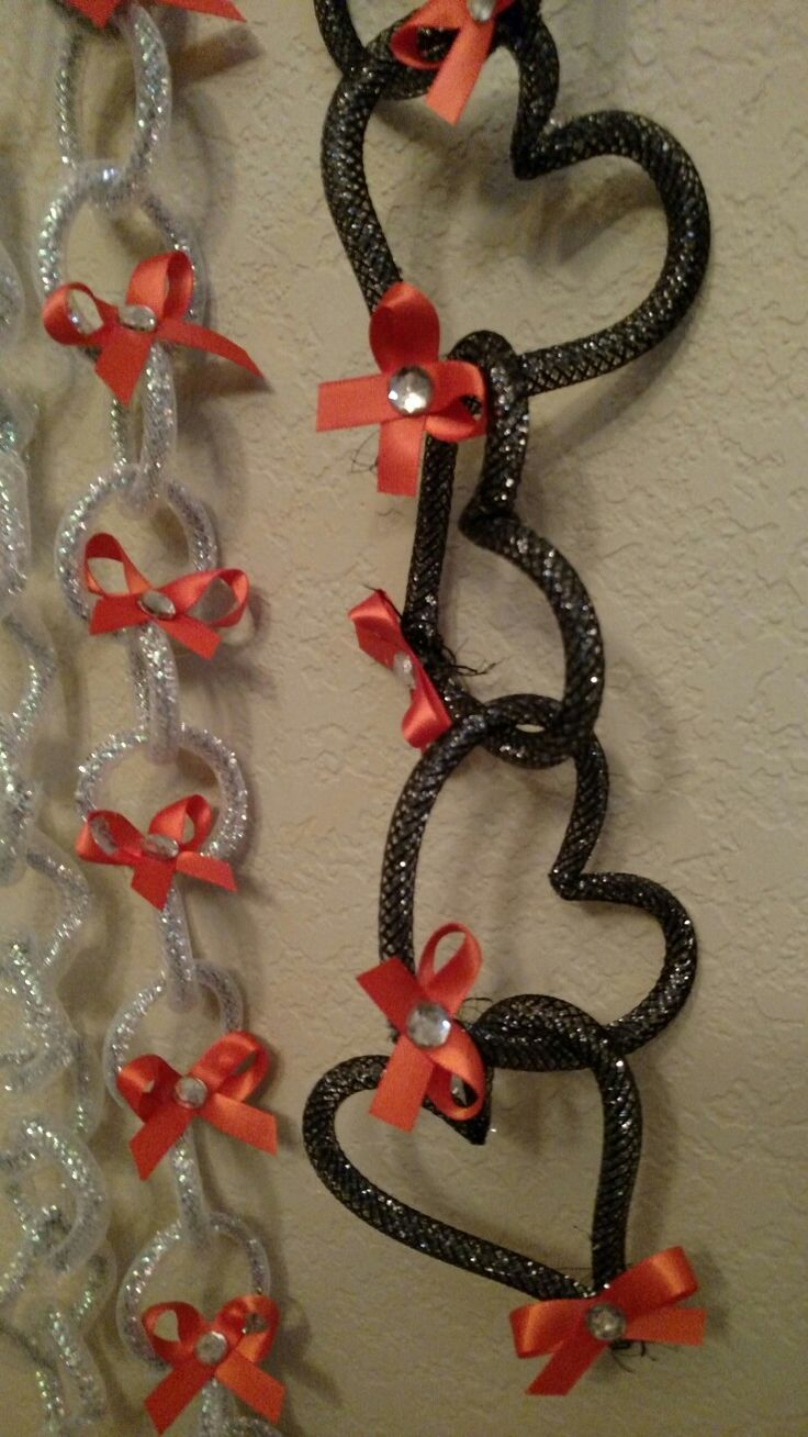 Homecoming mum spirit chains. Silver black and orange ribbons. Designed by Crafty bug