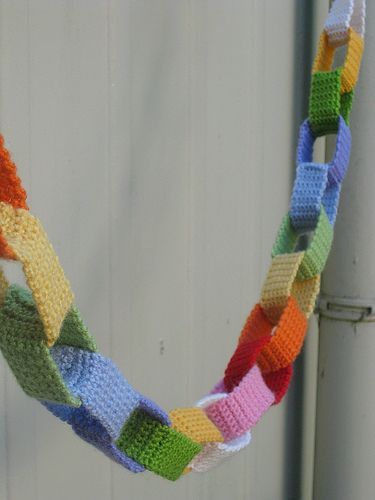 "Crocheted ""paper"" chain garland--could do this for any season, but red, green and white (how about ALL gold?) would make a great garland for the tree or bunting to string over the mantle or from the tops of curtain rods."