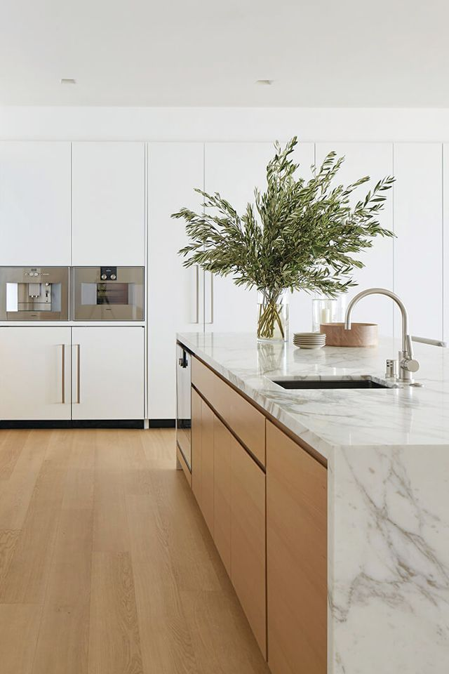 Add color and texture with vases of greenery. Sleek, pared-back kitchens provide an ideal base to add accessories. A simple glass vase of verdant greenery adds height and visual interest.
