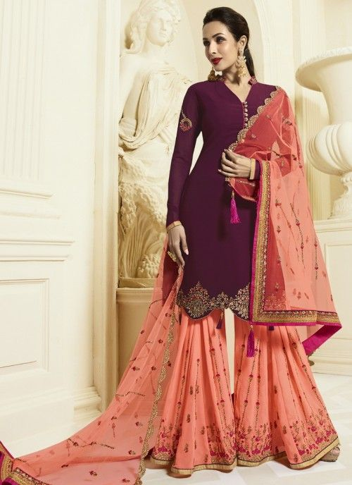 d282129ea3 Bollywood diva malaika arora style wine wedding sharara suit online which  is crafted from georgette fabric with exclusive zari embroidery and diamond  work.