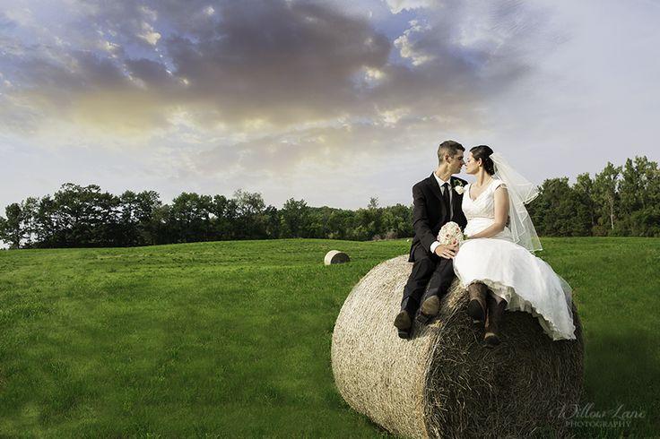 Farm wedding photos by Willow Lane Photography - Barrie Wedding Photographer www.willowlanephotography.ca Hay bale wedding photo