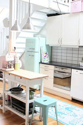 Love the soft baby blue on white and the retro. This made a really tiny kitchen feel roomy and bright, love it!