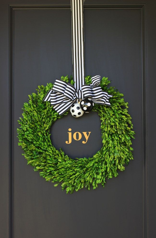 Black Gold And White Holiday Decor We Used A Boxwood Wreath Black Amp White Striped Ribbon And